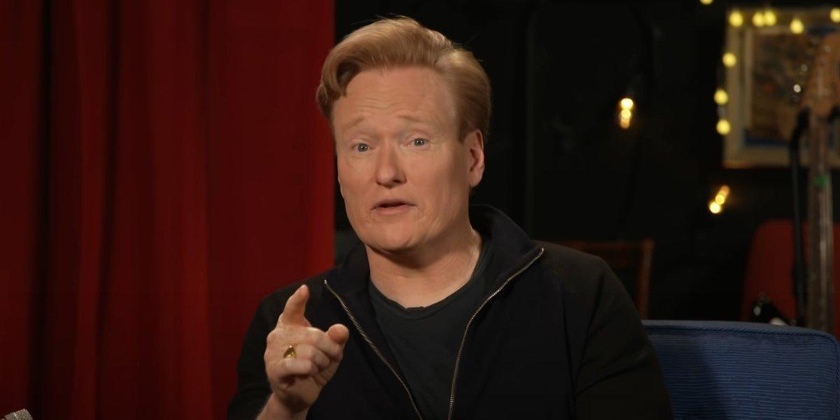 conan o'brien pointing at screen in tbs talk show
