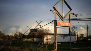A Domino's Pizza sign damaged by Hurricane Ida in Raceland, Louisiana, on Monday, Aug. 30, 2021.