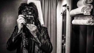 a portrait of nikki sixx with a camera in front of his face