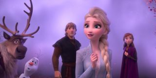 Sven, Olaf, Kristoff and Anna look intrigued as they stand behind Elsa in a scene from Frozen II
