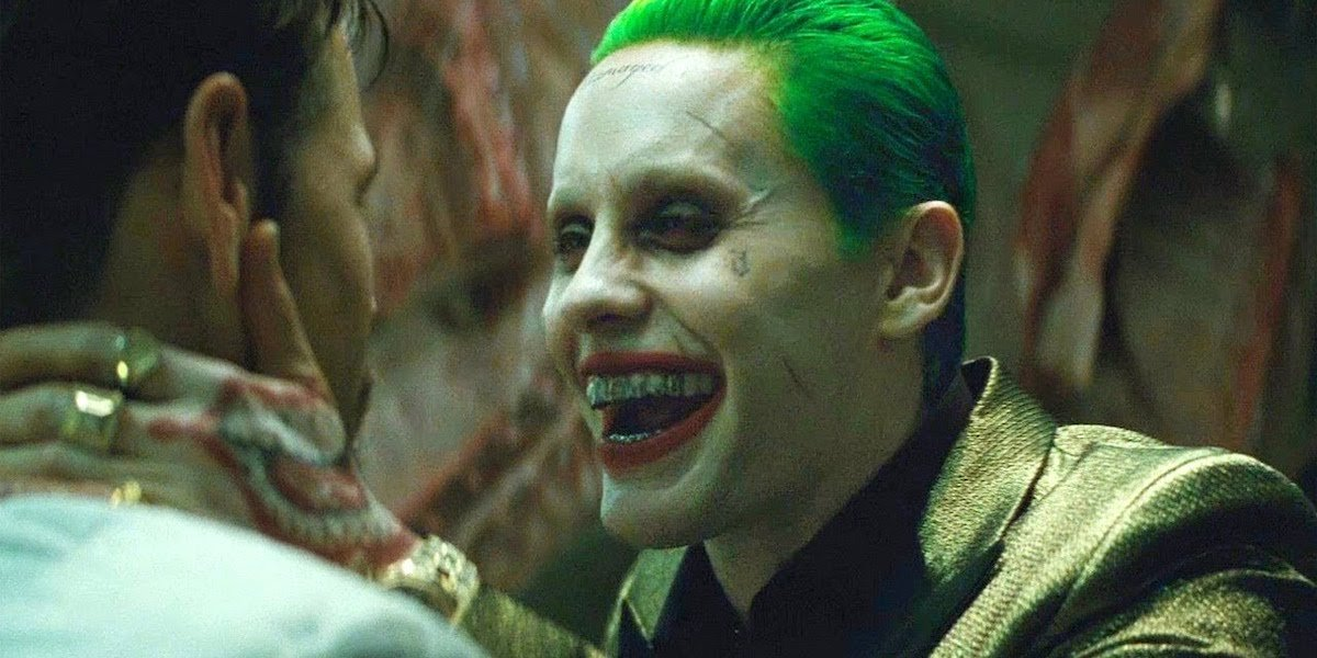 Jared Leto as Joker laughing in someone's face in David Ayer's Suicide Squad