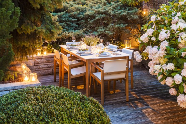 Laid table on a decked terrace with candles