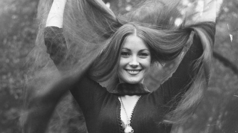 Model and actress Jane Seymour shows off her long tresses in the park, London.