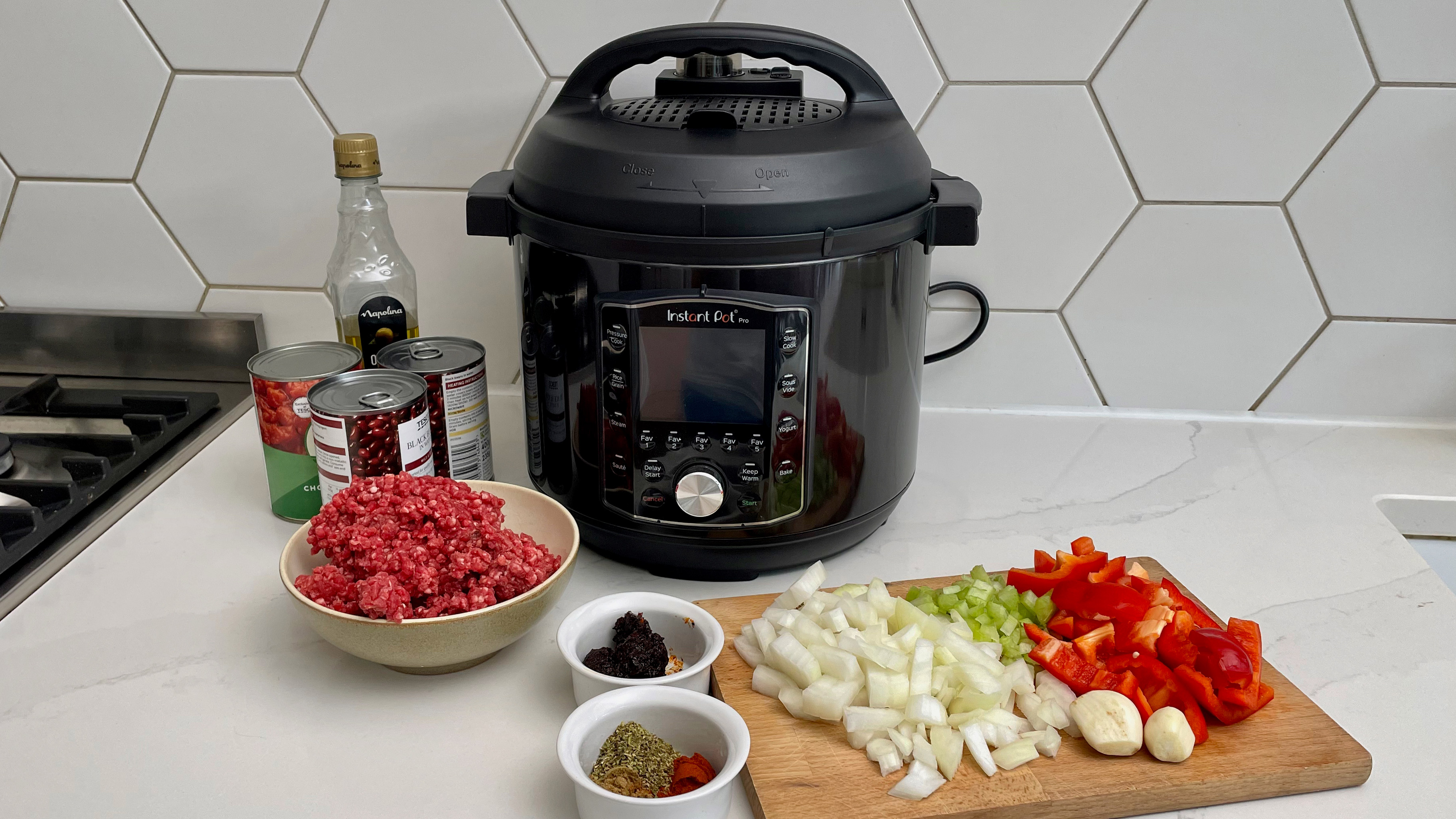 Instant Pot Pro surrounded by ingredients to make a slow cooked chilli