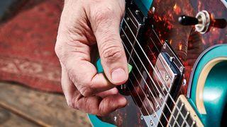 Picking electric guitar stock shot