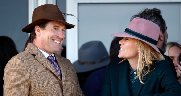 Peter Phillips and Autumn Phillips watch the racing as they attend day four 'Gold Cup Day' of the Cheltenham Festival 2020 at Cheltenham Racecourse on March 13, 2020 in Cheltenham, England.
