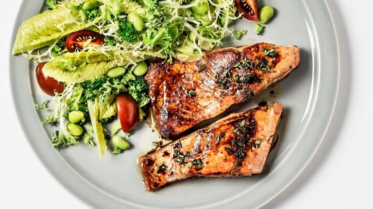 Salmon and salad, part of a Mediterranean diet