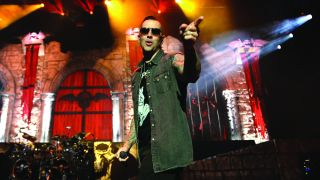 A photograph of M Shadows onstage