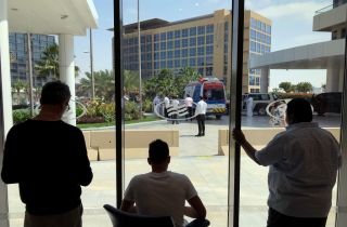 A view from inside the Crowne Plaza hotel, which is on lockdown due to fears of the Corona Virus, looking towards the hotel where cyclists from the UAE Tour are being held