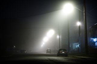 a foggy street at night