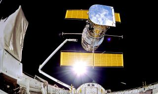 Astronauts deployed the Hubble Space Telescope from the space shuttle Discovery in 1990.
