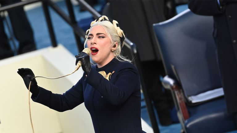 TOPSHOT - US Singer Lady Gaga sings the US National Anthem at the beginning of the swearing in ceremony of the 46th US President on January 20, 2021, at the US Capitol in Washington, DC. (Photo by SAUL LOEB / POOL / AFP) (Photo by SAUL LOEB/POOL/AFP via Getty Images)