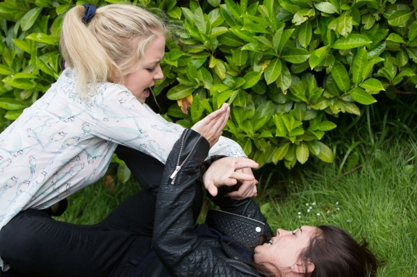 Abi Branning played by Lorna Fitzgerald attacks Stacey Branning played by Lacey Turner