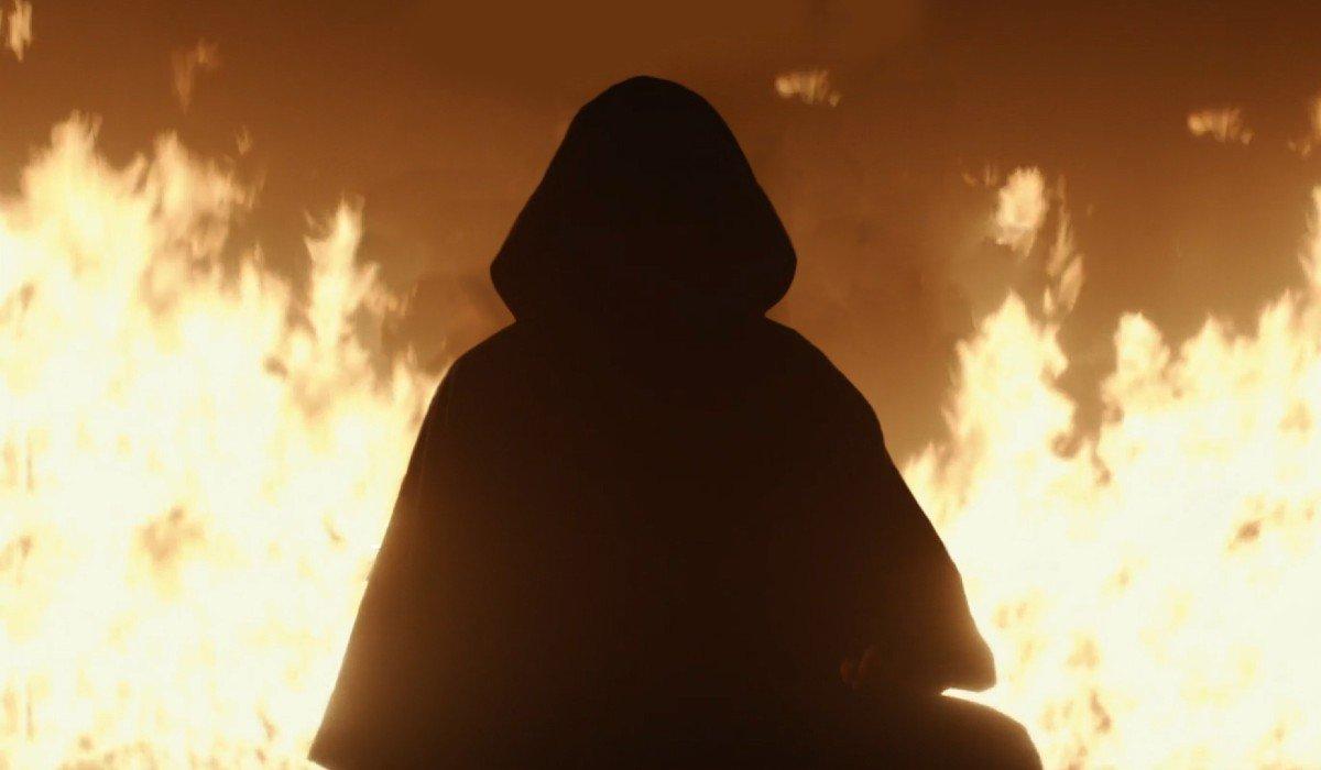 Hooded figure in the flames Loki Disney+