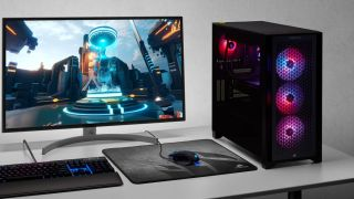 Corsair Vengeance i7200 PC, monitor, keyboard, mouse, and headset on a desk.