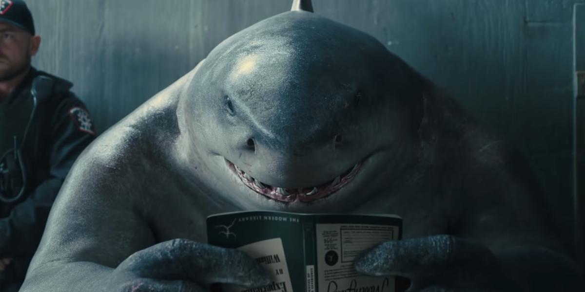 King Shark reading a book