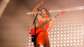 St Vincent plays guitar live on stage