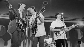 The Beatles perform live