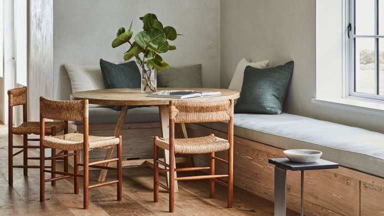 Small dining room nook withe circular table and build in bench