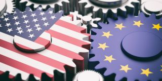 Stock image of US and EU flags as gears