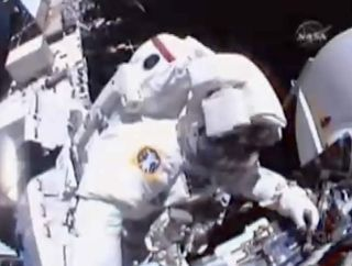 Spacewalkers Install New Batteries, Free Snagged Cable on Station