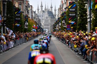 LEUVEN BELGIUM SEPTEMBER 26 A general view of the Peloton passing through Leuven City while fans cheer during the 94th UCI Road World Championships 2021 Men Elite Road Race a 2683km race from Antwerp to Leuven flanders2021 on September 26 2021 in Leuven Belgium Photo by Kristof Ramon PoolGetty Images