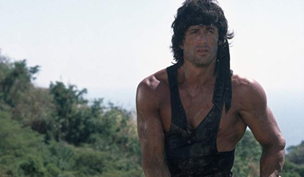 Rambo: First Blood II Sylvester Stallone looking jacked in a tank top