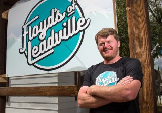 Floyd Landis poses for a portrait in front of his office for Floyd's of Leadville on August 13, 2016
