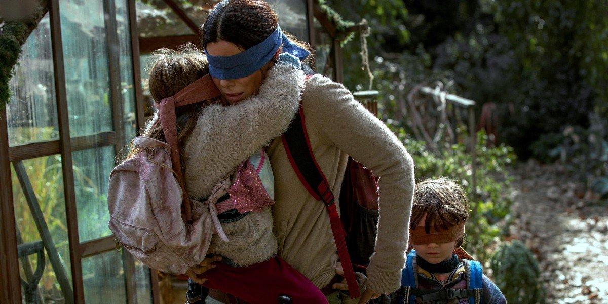 Sandra Bullock, Vivien Lyra Blair, and Julian Edwards in Bird Box