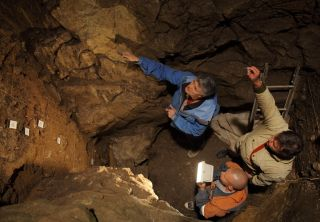 Scientists found DNA related to the extinct human lineage called Denisovans in Denisova Cave in Siberia. Here, Richard (Bert) Roberts, Vladimir Ulianov and Maxim Kozlikin (clockwise from top) plan the sampling of sediments in the cave's east chamber.