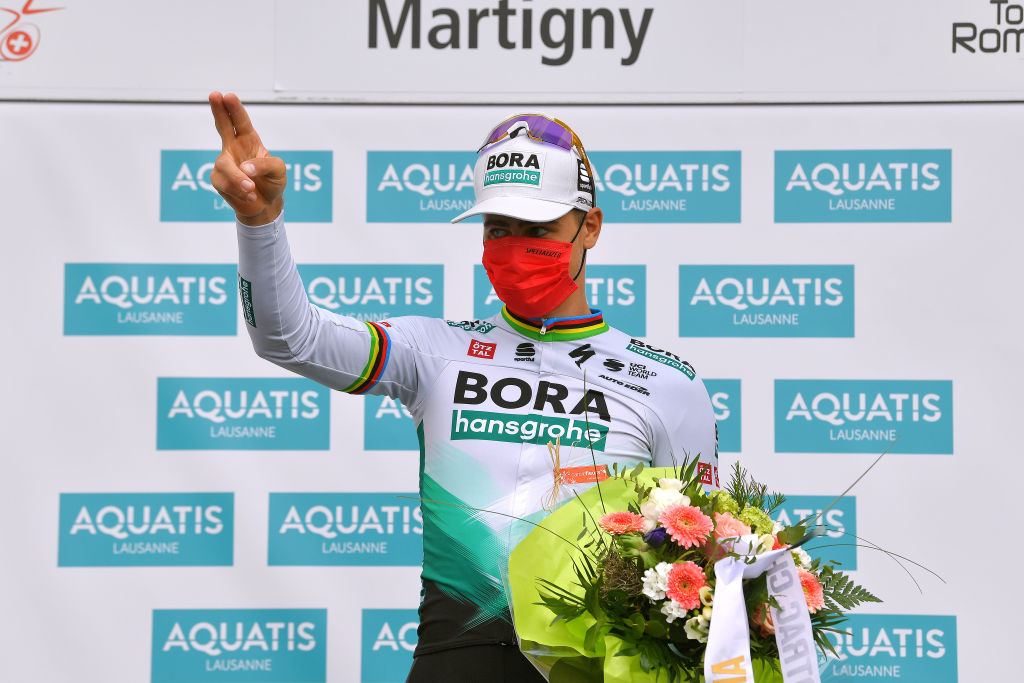 MARTIGNY SWITZERLAND APRIL 28 Peter Sagan of Slovakia and Team Bora Hansgrohe stage winner celebrates at podium during the 74th Tour De Romandie 2021 Stage 1 a 1681km stage from Aigle to Martigny Mask Covid safety measures Flowers TDR2021 TDRnonstop UCIworldtour on April 28 2021 in Martigny Switzerland Photo by Luc ClaessenGetty Images