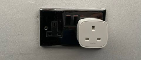 D-Link Mini Wi-Fi Smart Plug DSP-W118 plugged into a silver power outlet