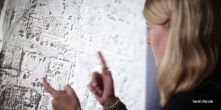 Space archaeologist Sarah Parcak examines a satellite image.
