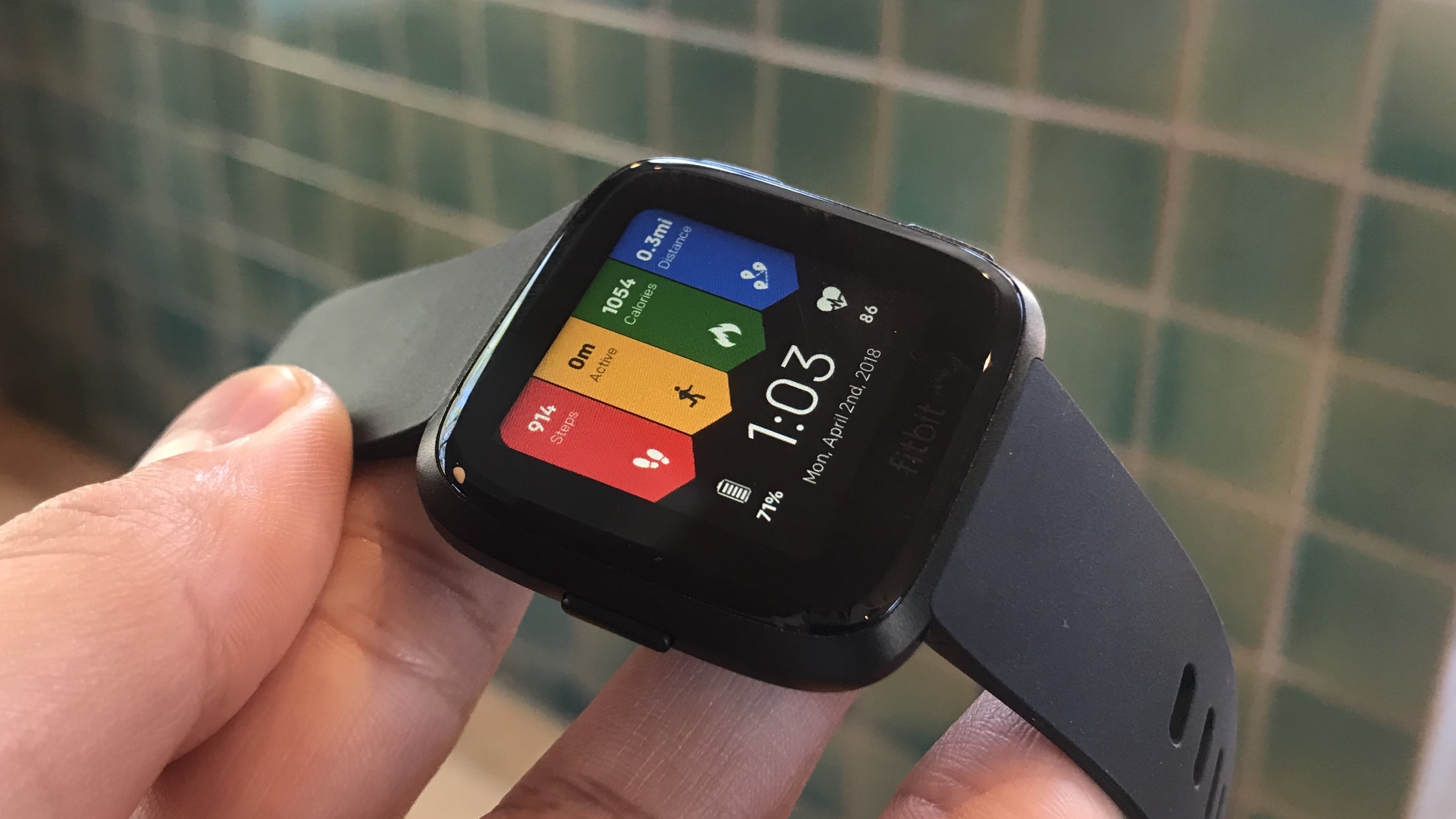 The Versa's digital clock display is completely customizable through the Fitbit app