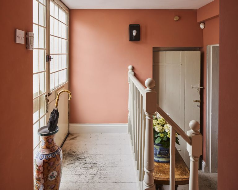 Hallway with peach colored walls