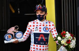 Team Ineos rider Ecuadors Richard Carapaz celebrates his best climbers polka dot jersey on the podium at the end of the 18th stage of the 107th edition of the Tour de France cycling race 168 km between Meribel and La Roche sur Foron on September 17 2020 Photo by AnneChristine POUJOULAT POOL AFP Photo by ANNECHRISTINE POUJOULATPOOLAFP via Getty Images
