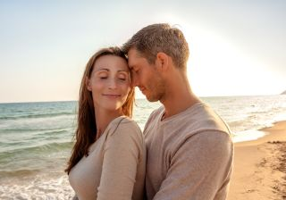 An attractive couple on the beach.