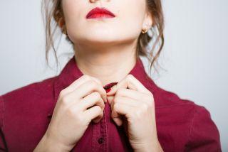 Woman buttons shirt