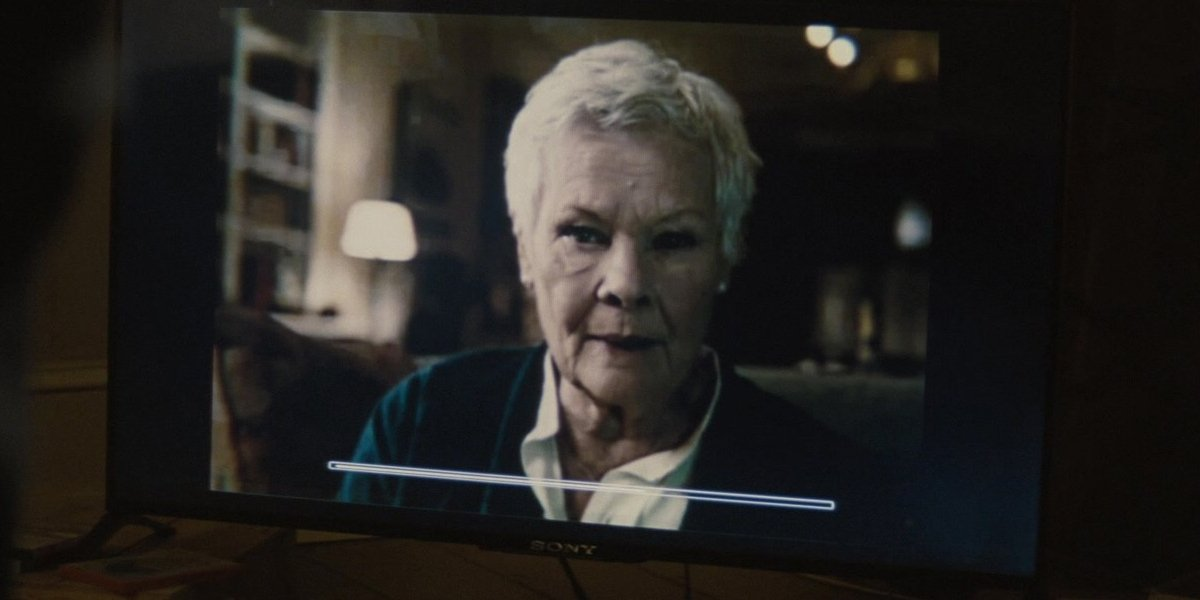 Dame Judi Dench appears through a pre-recorded message in Spectre.