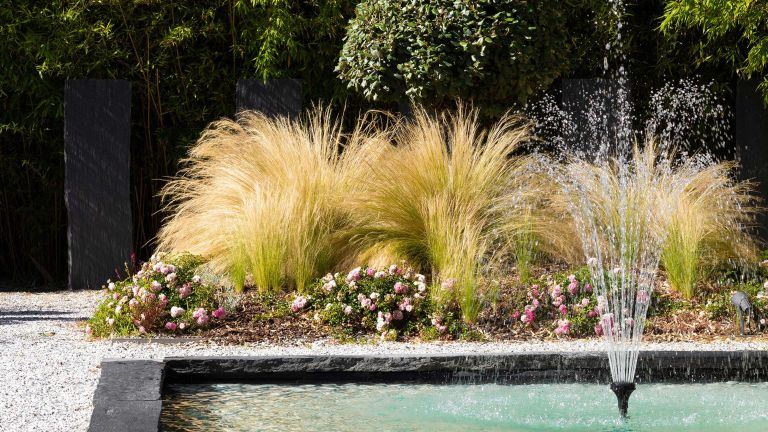 fountain ideas for gardens and backyards: fountain in pond with gravel and slate