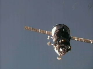 The Russian Soyuz TMA-03M pulls up to the International Space Station on Dec. 23, 2011 to deliver three new members of the orbiting lab's crew.