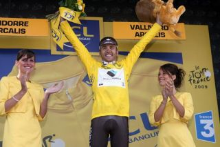 Italian Rinaldo Nocentini (AG2R La Mondiale) celebrates on the podium.