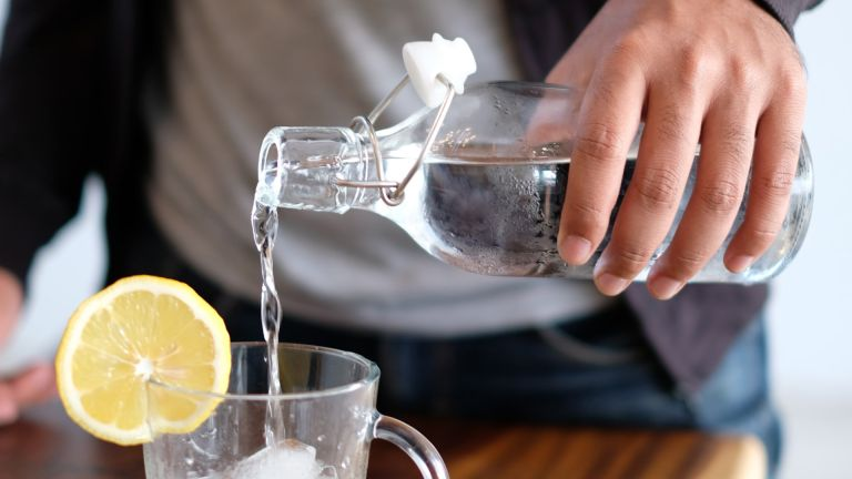 Pouring water with lemon slice