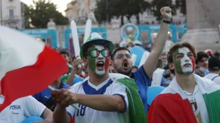 Italy fans watch their team's match against Belgium on July 2 from Piazza del Popolo in Rome..
