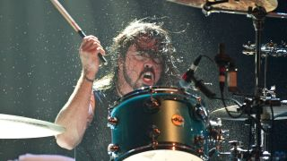 A photograph of rock drummer Dave Grohl on stage