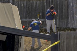 "Law enforcement authorities look for evidence at the home of suspected ""Golden State Killer"" Joseph James DeAngelo in Citrus Heights, California, on Wednesday, April 25, 2018."