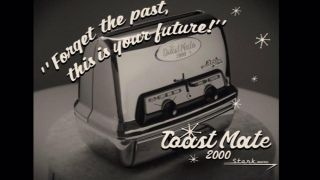 "A black and white photo of a toaster, the text around reads ""Forget the past, this is your future!"" Toast Mate 2000 Stark Industry"