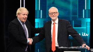 SALFORD, ENGLAND - NOVEMBER 19: (AVAILABLE FOR EDITORIAL USE UNTIL DECEMBER 19, 2019) In this handout image supplied by ITV, Prime Minister Boris Johnson and Leader of the Labour Party Jeremy Corbyn shake hands during the ITV Leaders Debate at Media Centre on November 19, 2019 in Salford, England. This evening ITV hosted the first televised head-to-head Leader's debate of this election campaign. Leader of the Labour party, Jeremy Corbyn faced Conservative party leader, Boris Johnson after the SNP and Liberal Democrats lost a court battle to be included.