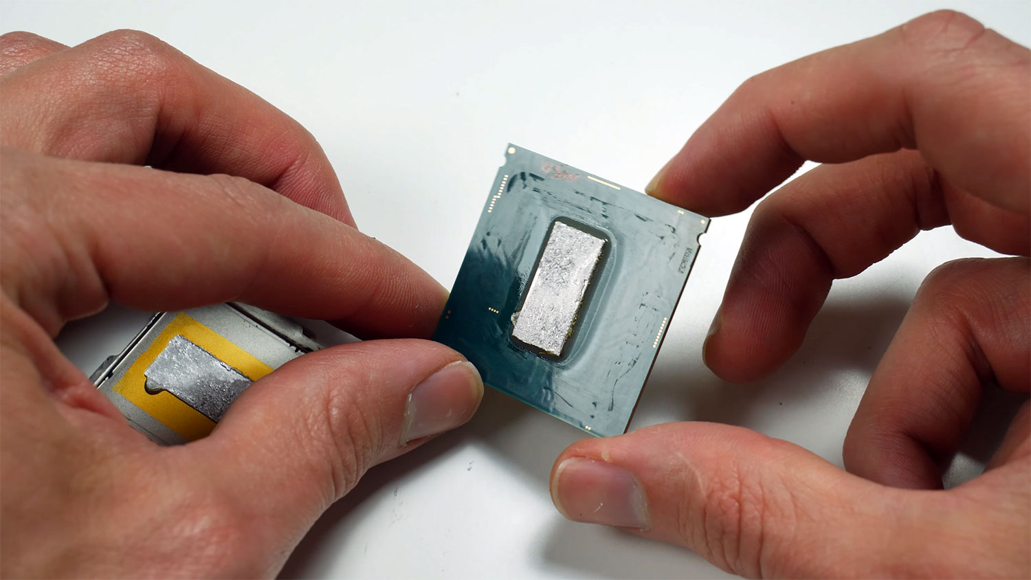 Watch a professional overclocker delid and sand down an