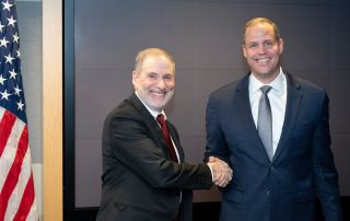 Douglas Loverro (left) shakes hands with NASA Administrator Jim Bridenstine after being sworn in to his new position as the associate administrator of NASA's Human Exploration and Operations Mission Directorate, on Dec. 2, 2019.